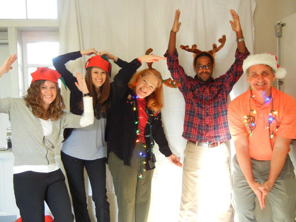 Staff spell UMCH at Christmas photo booth