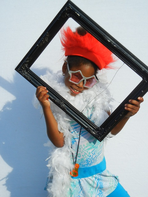 Child poses for a fun photo booth shot