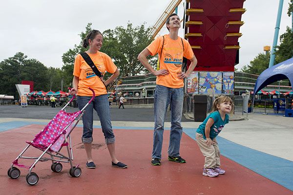 The Harwood family watches friends prepare to descend on a nearby roller coaster.