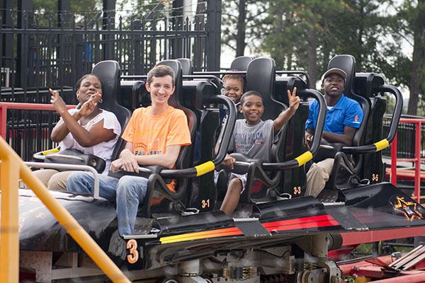 Fam Fest guests prepare to ascend the Dare Devil roller coaster.
