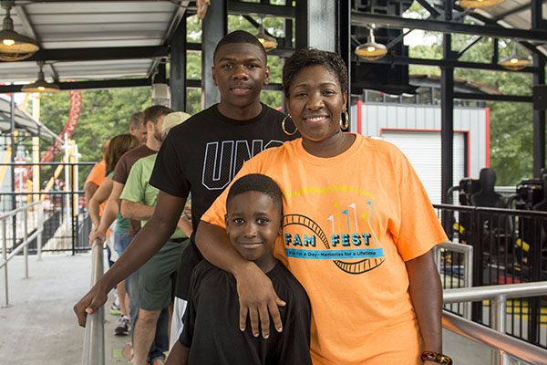 Yolanda White and her sons in line for the Dare Devil roller coaster.