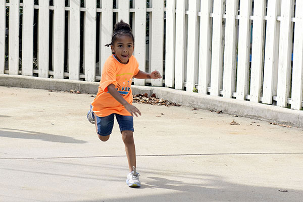 Five-year-old Cadence Thomas runs to the next ride.